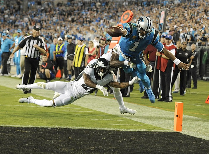 Carolina Panthers' Cam Newton (1) dives for the end zone as Philadelphia Eagles' Patrick Robinson (21) and Rodney McLeod (23) defend in the second half of an NFL football game in Charlotte, N.C., Thursday, Oct. 12. Newton was ruled down before the goal line. (Mike McCarn/AP)