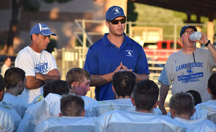 Camp Verde assistant coach Jake Spleiss addresses the Cowboys' after their scrimmage against Scottsdale Prep. Spleiss was a star football and basketball player at CV.  (VVN/James Kelley)