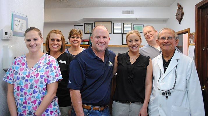 Doctors and staff pose for a picture Wednesday afternoon. Dr. Bryan Shanahan acquired Dr. William F. Guth's dentistry practice Oct.6. Dr. Guth, who began the Cottonwood practice in 1981, is retiring, but still working alongside doctors and staff to ensure a smooth transition. (VVN/Jennifer Volpe)