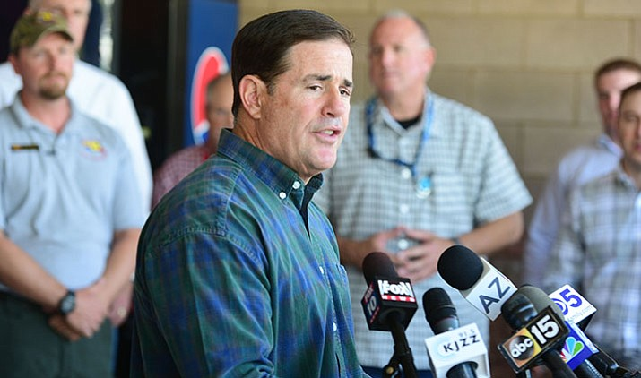 Arizona Governor Doug Ducey has promised he won't raise taxes. His next budget may have to make cuts of up to $200 million. (Les Stukenberg/Courier file)