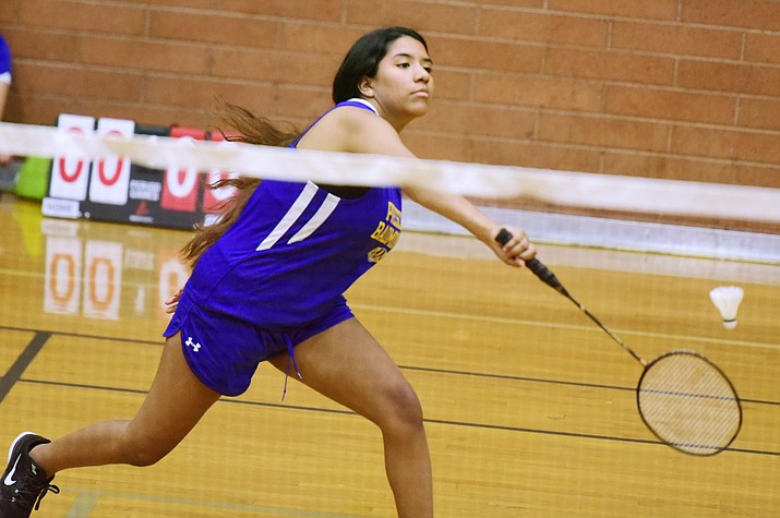 Prescott's Zoey Frazier hits a backhand return as the Badgers take on Raymond Kellis in a badminton match Wednesday in Prescott. (Les Stukenberg/Courier)