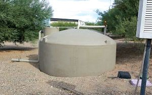 A rainwater harvesting tank was installed on Lake Havasu City property. The storage systems provide enough water to cover all landscaping needs on the property.