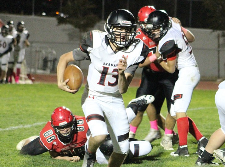 Bradshaw Mountain quarterback Austin Gonzales runs for some yardage against Lee Williams on Friday, Oct. 13, 2017, in Kingman. (Beau Bearden/Kingman Daily Miner)