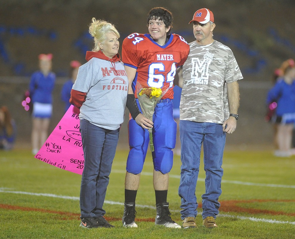 Mayer's Jared LaRue and his family enjoy senior night as the Wildcats faced the Bagdad Sultans Friday night in a matchup of top 4 teams in the AIA 1A rankings in Mayer. (Les Stukenberg/Courier)