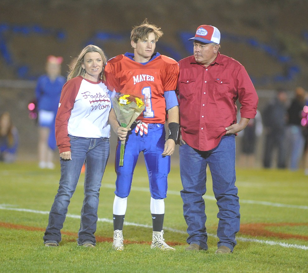 Mayer's Dylan WIlhide and his family enjoy senior night as the Wildcats faced the Bagdad Sultans Friday night in a matchup of top 4 teams in the AIA 1A rankings in Mayer. (Les Stukenberg/Courier)