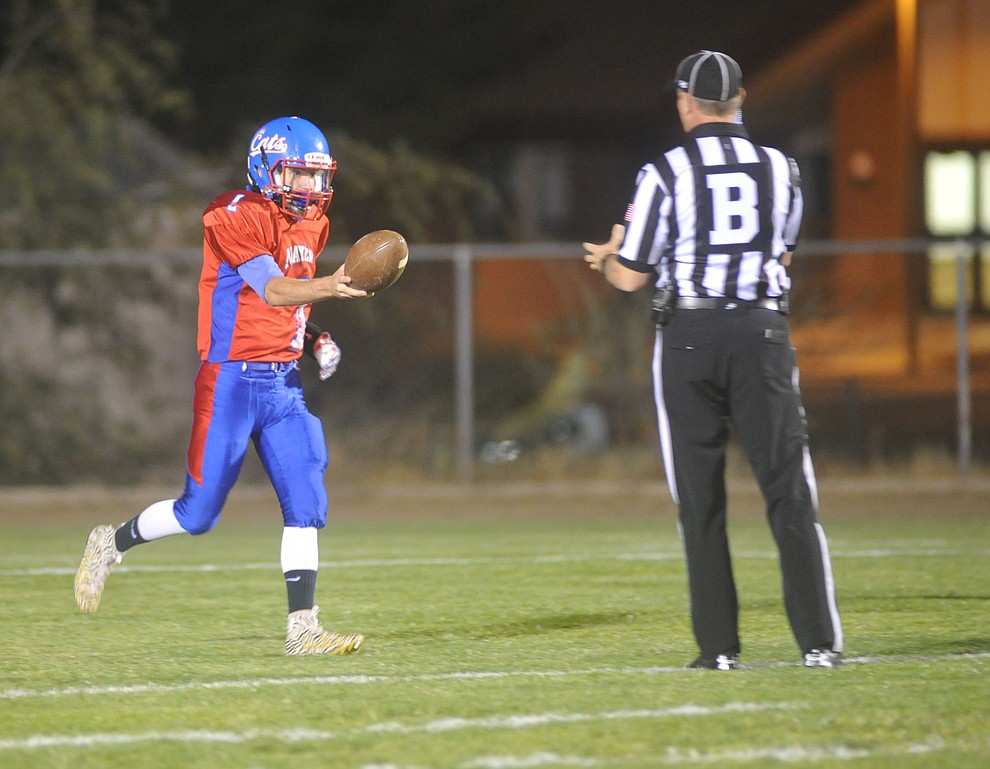 Mayer's Dylan Wilhide (1) hands the ball back to the backjudge after running for a opening touchdown as the Wildcats faced the Bagdad Sultans Friday night in a matchup of top 4 teams in the AIA 1A rankings in Mayer. (Les Stukenberg/Courier)
