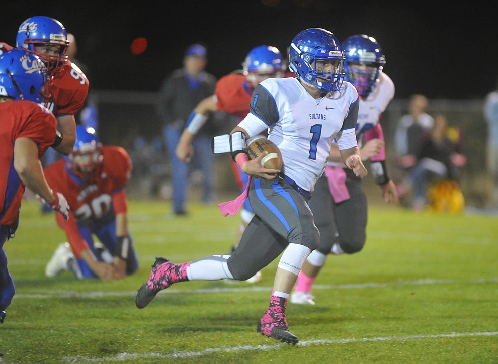 Bagdad quarterback Israel Loveall (1) breaks into the open field as the Sultans faced the Mayer Wildcats Friday night in a matchup of top 4 teams in the AIA 1A rankings in Mayer. (Les Stukenberg/Courier)
