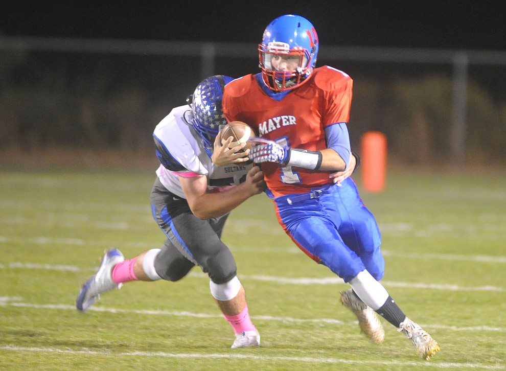Mayer's Dylan Wilhide (1) looks for running room as the Wildcats faced the Bagdad Sultans Friday night in a matchup of top 4 teams in the AIA 1A rankings in Mayer. (Les Stukenberg/Courier)