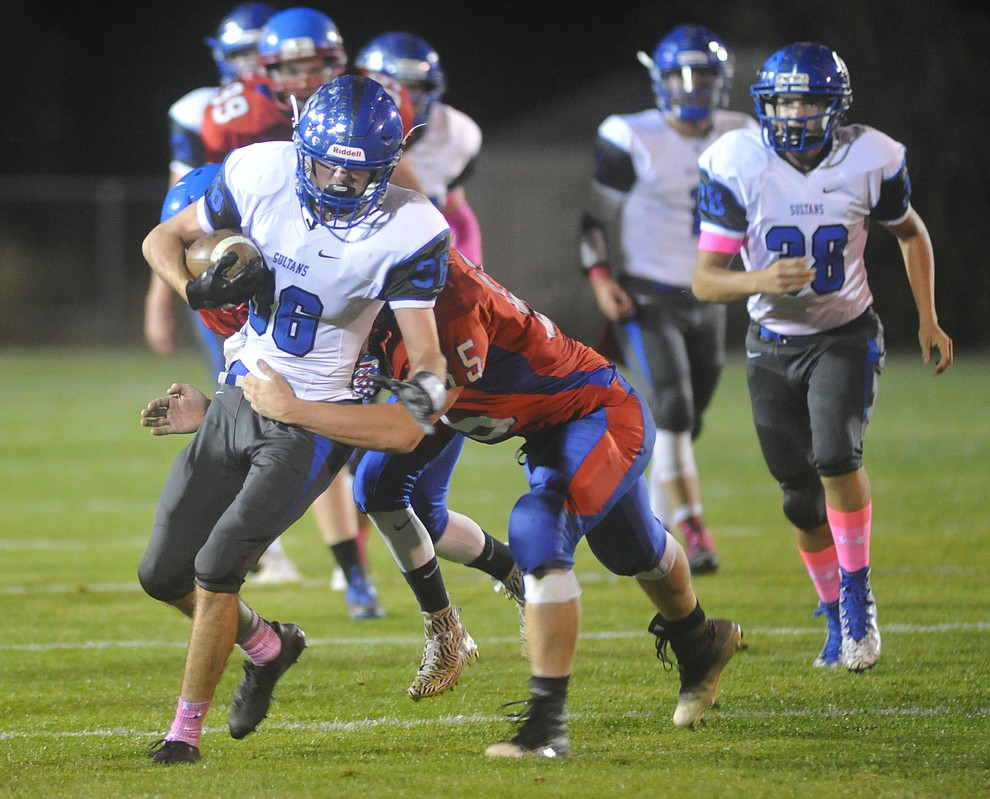 Bagdad's Rio Delgado (36) runs for yards after a catch as the Sultans faced the Mayer Wildcats Friday night in a matchup of top 4 teams in the AIA 1A rankings in Mayer. (Les Stukenberg/Courier)