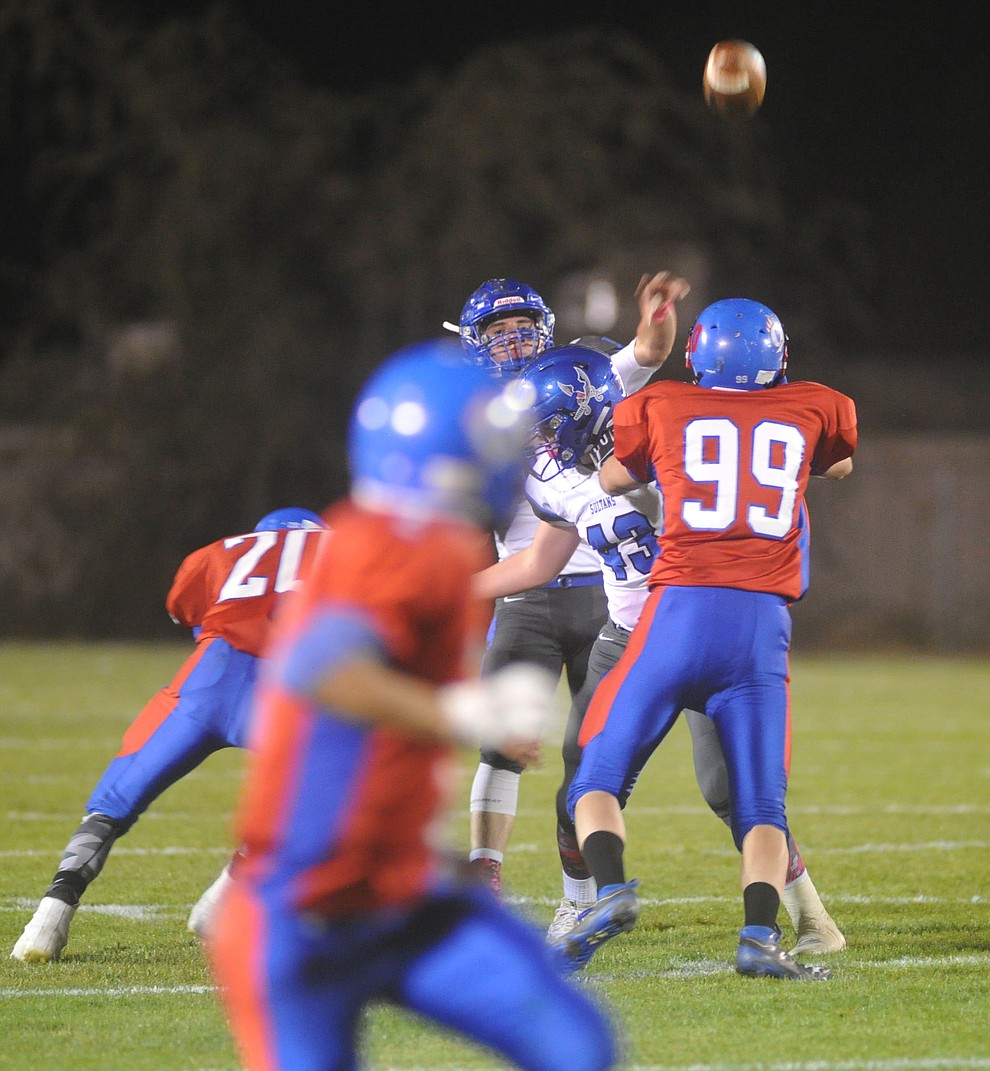 Bagdad quarterback Israel Loveall (1) launches a perfect spiral downfield as the Sultans faced the Mayer Wildcats Friday night in a matchup of top 4 teams in the AIA 1A rankings in Mayer. (Les Stukenberg/Courier)