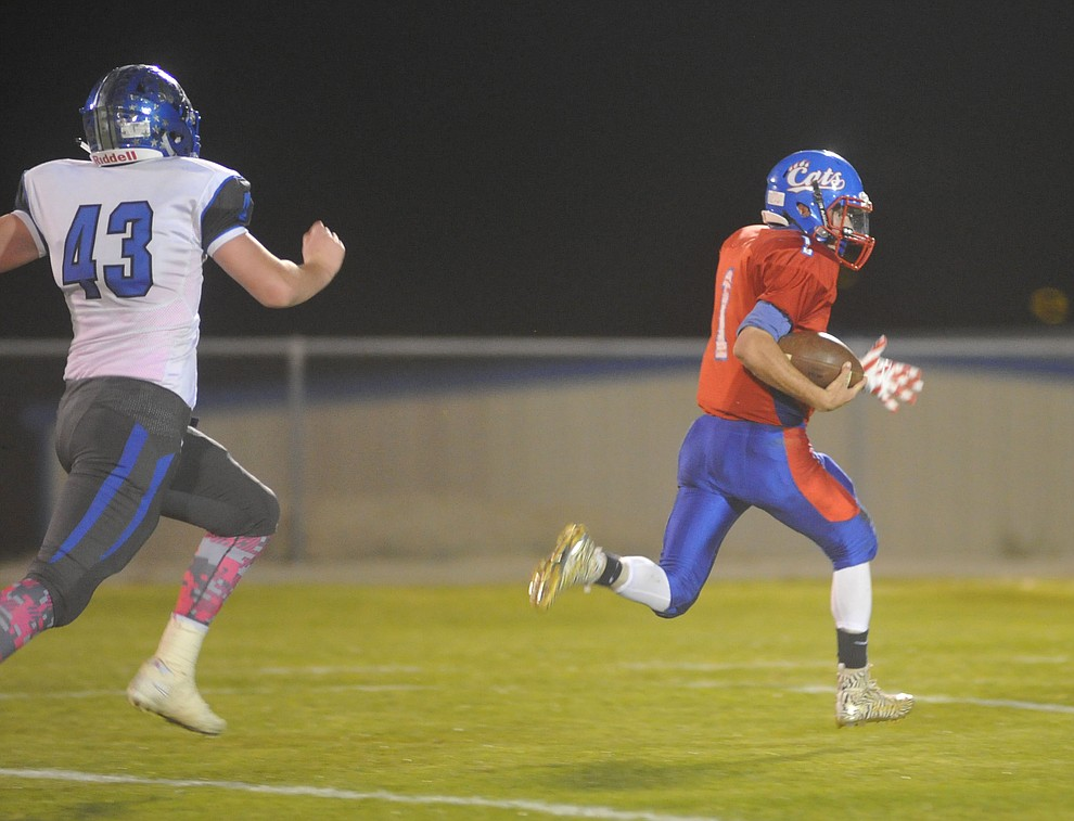 Mayer's Dylan Wilhide runs for another touchdown as the Wildcats faced the Bagdad Sultans Friday night in a matchup of top 4 teams in the AIA 1A rankings in Mayer. (Les Stukenberg/Courier)