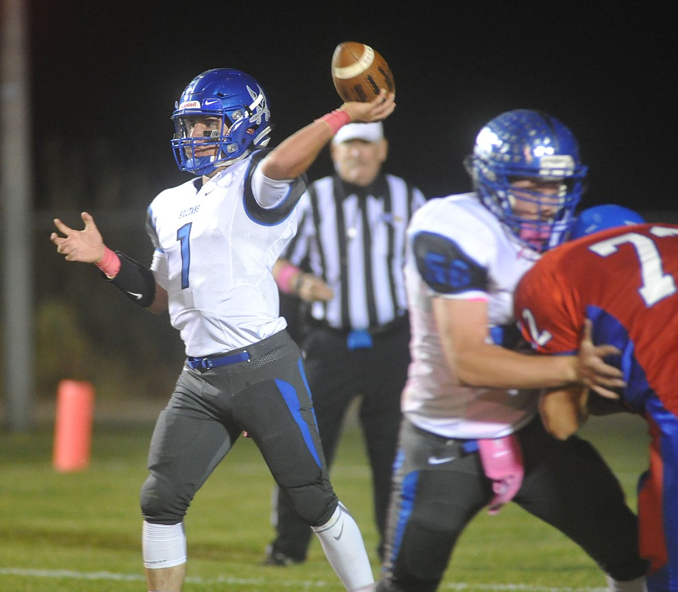Bagdad quarterback Israel Loveall (1) throws a pass downfield as the Sultans faced the Mayer Wildcats Friday night in a matchup of top 4 teams in the AIA 1A rankings in Mayer. (Les Stukenberg/Courier)
