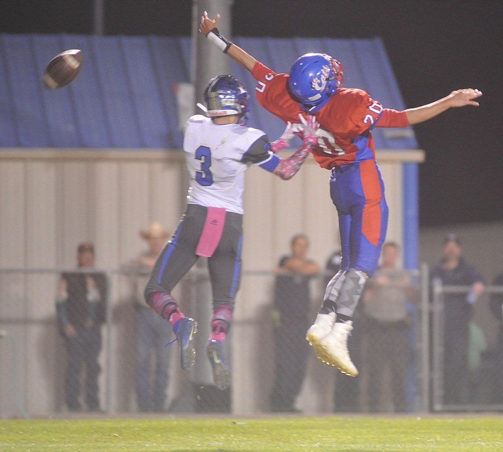 Mayer's Garrett Urquides (20) just misses a pass as the Wildcats faced the Bagdad Sultans Friday night in a matchup of top 4 teams in the AIA 1A rankings in Mayer. (Les Stukenberg/Courier)