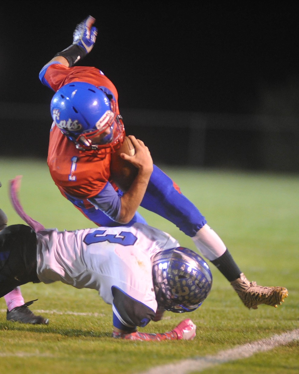 Mayer's Dylan Wilhide (1) gets tackled on the sidelines by Scotty Finnerty (3) as the Wildcats faced the Bagdad Sultans Friday night in a matchup of top 4 teams in the AIA 1A rankings in Mayer. (Les Stukenberg/Courier)