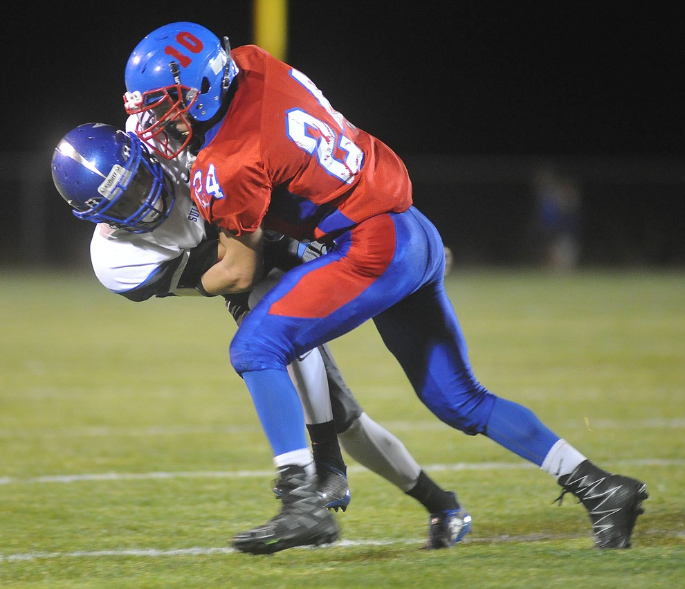 Mayer's Dade Herbert (24) makes a tackle as the Wildcats faced the Bagdad Sultans Friday night in a matchup of top 4 teams in the AIA 1A rankings in Mayer. (Les Stukenberg/Courier)