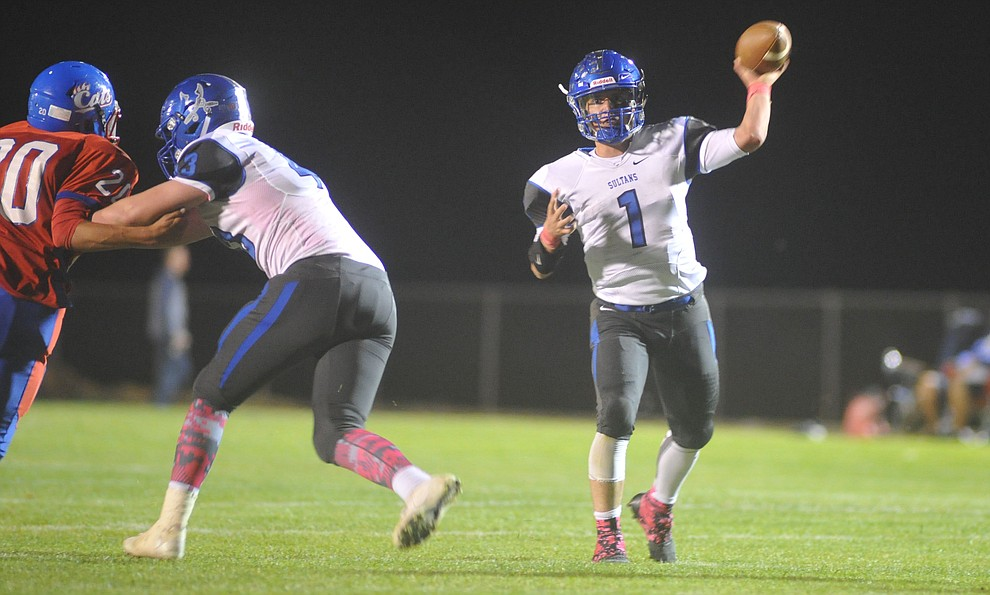 Bagdad's Israel Loveall (1) throws downfield as the Sultans faced the Mayer Wildcats Friday night in a matchup of top 4 teams in the AIA 1A rankings in Mayer. (Les Stukenberg/Courier)