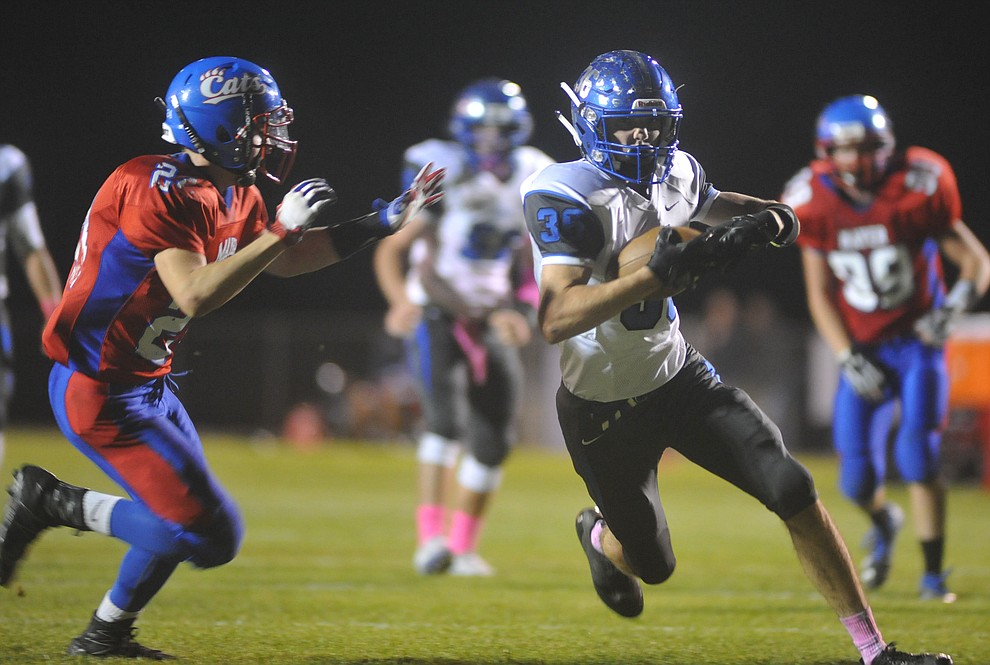 Bagdad's Rio Delgado (36) runs as the Sultans faced the Mayer Wildcats Friday night in a matchup of top 4 teams in the AIA 1A rankings in Mayer. (Les Stukenberg/Courier)