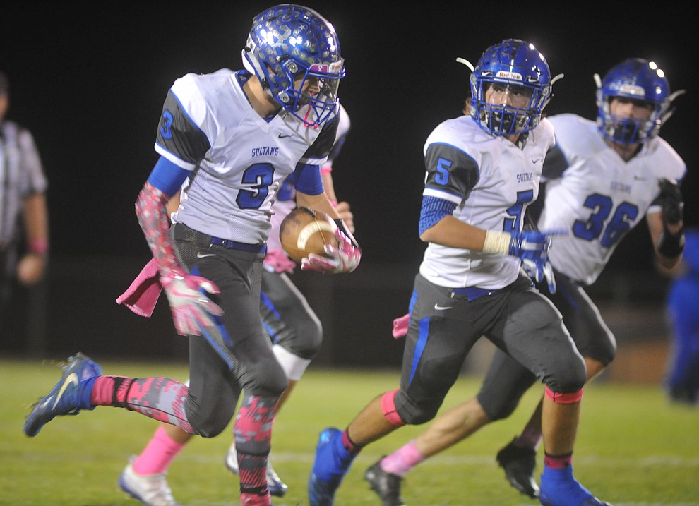 Bagdad's Scotty Finnerty (3) has a convoy of blockers enroute to a touchdown as the Sultans faced the Mayer Wildcats Friday night in a matchup of top 4 teams in the AIA 1A rankings in Mayer. (Les Stukenberg/Courier)