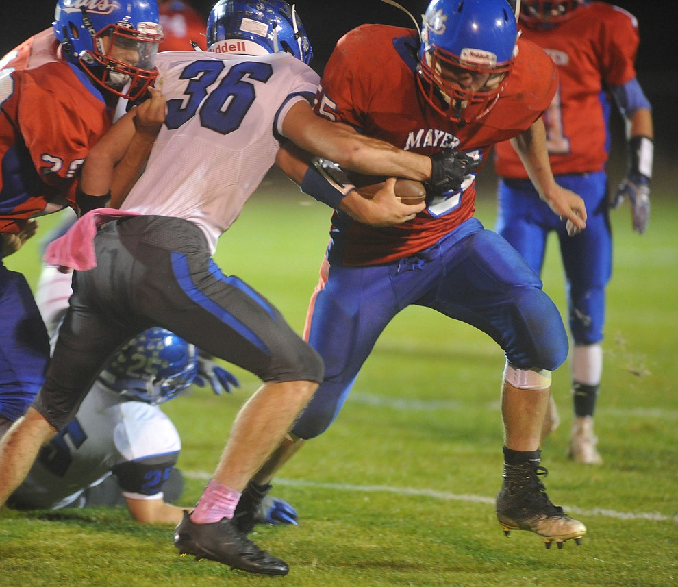 Mayer's Dacodah Jensen runs hard as the Wildcats faced the Bagdad Sultans Friday night in a matchup of top 4 teams in the AIA 1A rankings in Mayer. (Les Stukenberg/Courier)