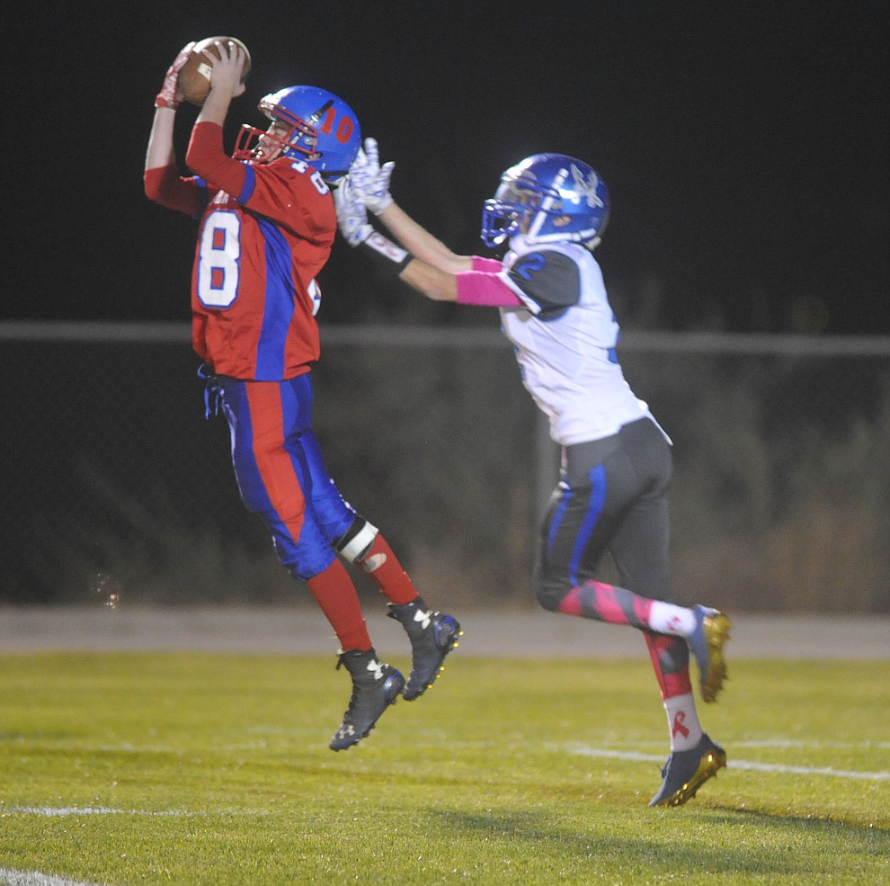 Mayer's Joseph Bauersachs (8) intercepts a pass as the Wildcats faced the Bagdad Sultans Friday night in a matchup of top 4 teams in the AIA 1A rankings in Mayer. (Les Stukenberg/Courier)