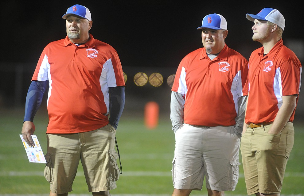 Mayer's coaching staff including Head Coach Mike Gutierrez, at left, as the Wildcats faced the Bagdad Sultans Friday night in a matchup of top 4 teams in the AIA 1A rankings in Mayer. (Les Stukenberg/Courier)