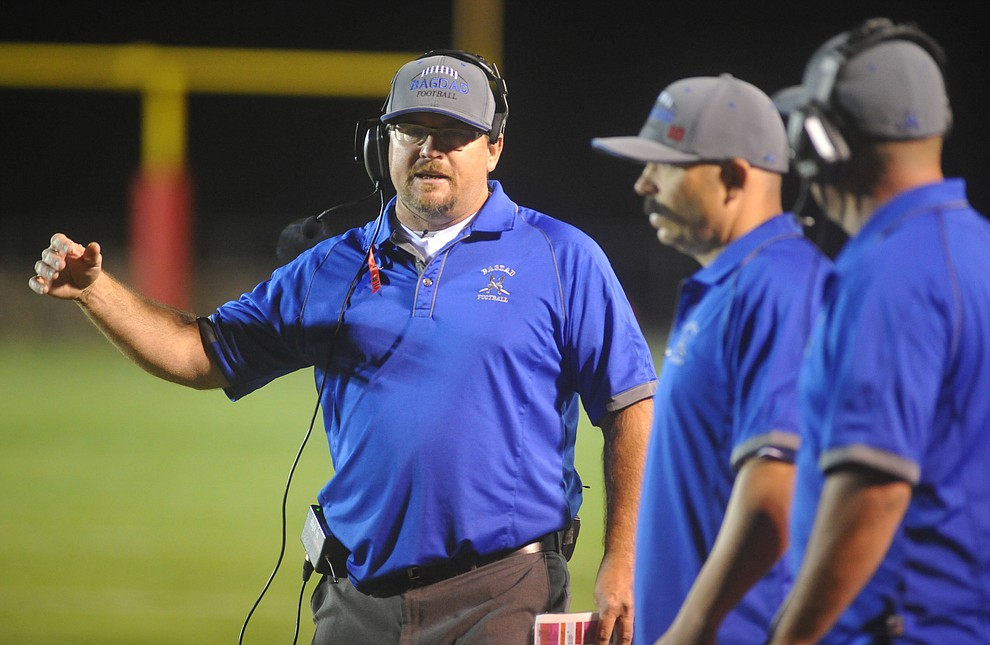 Bagdad's Head Coach Dalton Mills signals in a play as the Sultans faced the Mayer Wildcats Friday night in a matchup of top 4 teams in the AIA 1A rankings in Mayer. (Les Stukenberg/Courier)