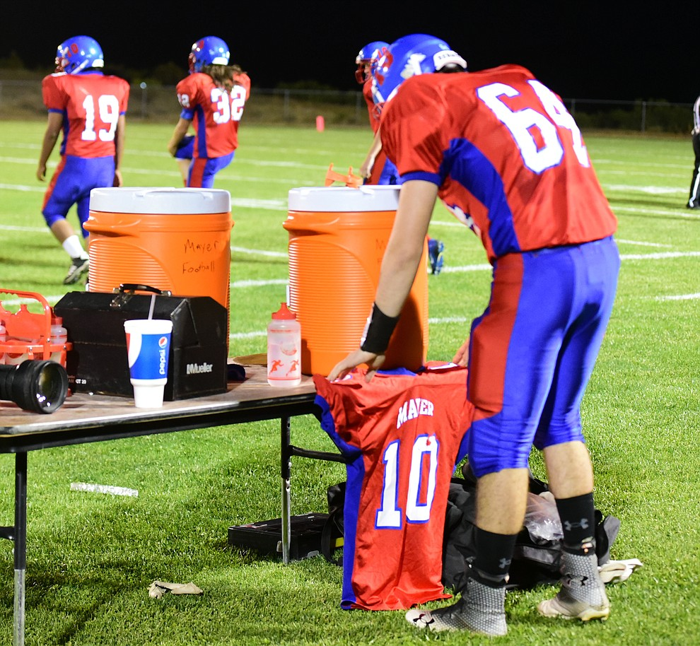 Mayer's Jared LaRue puts Cody Colquitt's jersey on the training table as the Wildcats faced the Bagdad Sultans Friday night in a matchup of top 4 teams in the AIA 1A rankings in Mayer. (Les Stukenberg/Courier)