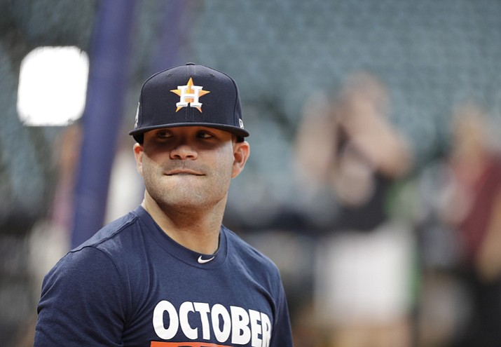 Houston Astros' Jose Altuve warms up before Game 1 of the American League Championship Series baseball game against the New York Yankees Friday, Oct. 13, 2017, in Houston. (David J. Phillip/AP)