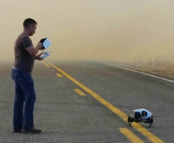Yavapai College unmanned aircraft instructor Matthew Mintzmyer, left, prepares to launch a drone Thursday, Oct. 12, along Route 66 west of Ash Fork. Mintzmyer had permission from fire officials to assist in fire spotting activities.