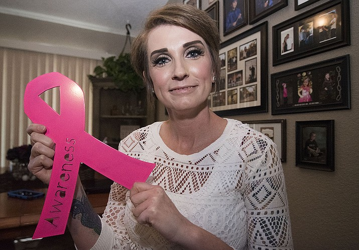 Holding up a metal pink ribbon that her son made Shannon Fitzgerald is a breast cancer survivor. In November 2015, The Daily Courier wrote about her initial diagnoses and the community support she received to help her get through the anticipated treatment. Now two years later, we've caught up with her to see how she's doing. (Les Stukenberg/Courier)