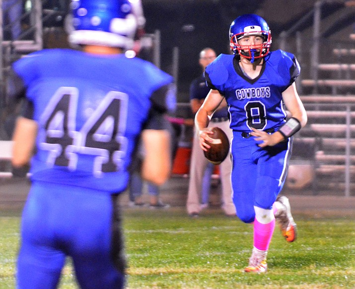 Camp Verde senior Payton Sarkesian surveys the  field during the Cowboys' 40-14 loss to Parker at home on Friday night. The game was Sarkesian's last at home of his high school career. (VVN/Vyto Starinskas)