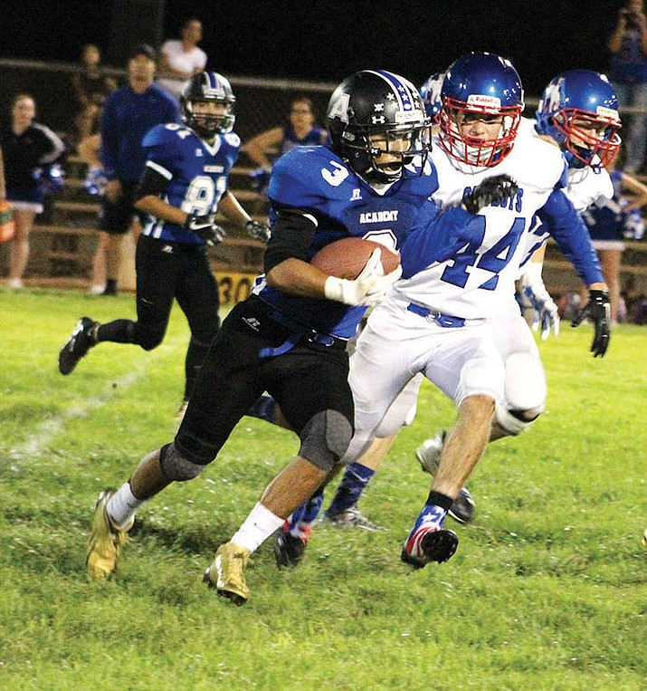 Kingman Academy's Gabe Imus rushed for 84 yards and a TD in a 30-20 loss to Tonopah Valley.