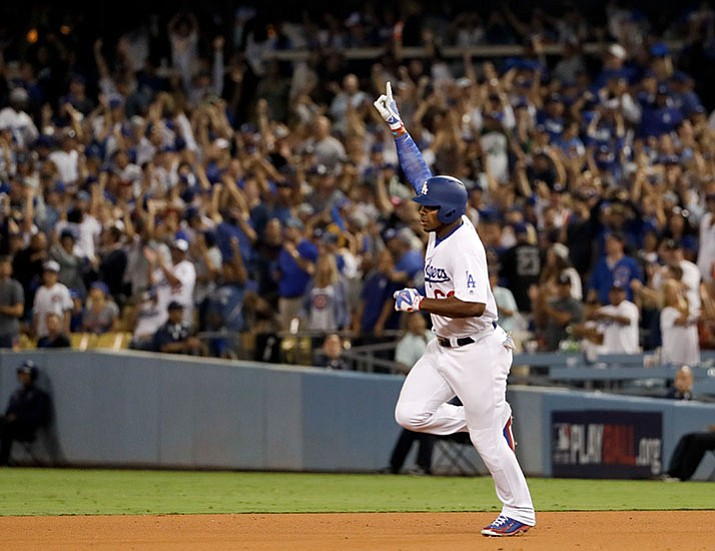 Los Angeles Dodgers' Yasiel Puig celebrates his home run against the Chicago Cubs during the seventh inning of Game 1 of baseball's National League Championship Series in Los Angeles, Saturday, Oct. 14. (Matt Slocum/AP)