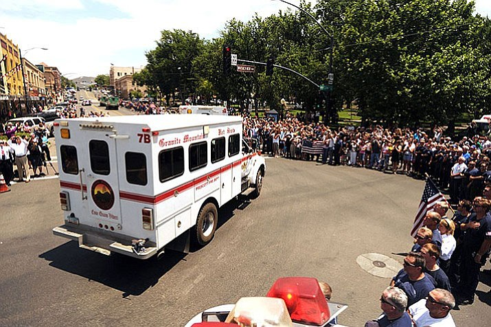 "The return of the Granite Mountain Hotshots' ""buggies"" to Prescott drew a large crowd July 4, 2013, honoring the 19 firefighters killed in the Yarnell Hill fire. The buggy is the crew's mode of transportation to and from fires and acts as a mobile command post/work station for the team while they are at base camp."