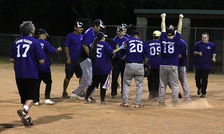 Verde Valley Diamondbacks celebrate their win over the varsity Mingus Union softball on Thursday night at Butler Park in Camp Verde. Later this month they will compete at the Special Olympics Fall Classic in Peoria. (VVN/James Kelley)