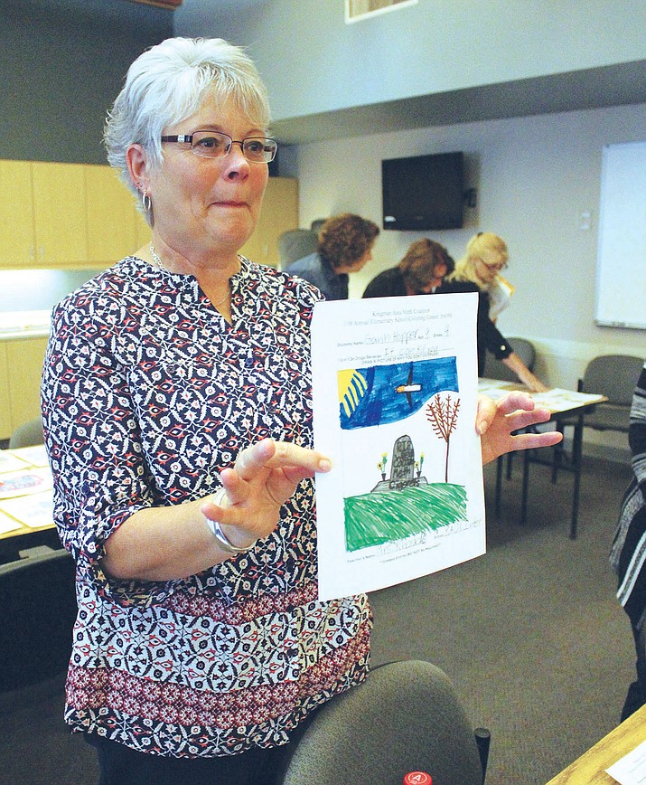 Laurie DeVries, chairwoman of the Kingman Area Meth Coalition, holds one of the many entries for the poster contest.