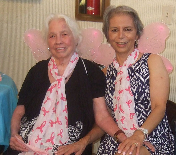 Ines Perez and Deborah Portzer — wearing wings — at a Celebration of Life. (Courtesy)