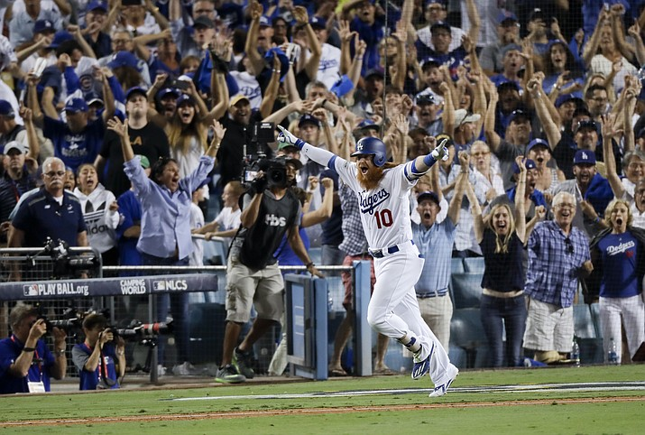 Los Angeles' Justin Turner celebrates after a three-run walk off home run against Chicago during the ninth inning of Game 2 of baseball's National League Championship Series in Los Angeles. The Dodgers won, 4-1. (Alex Gallardo/AP)