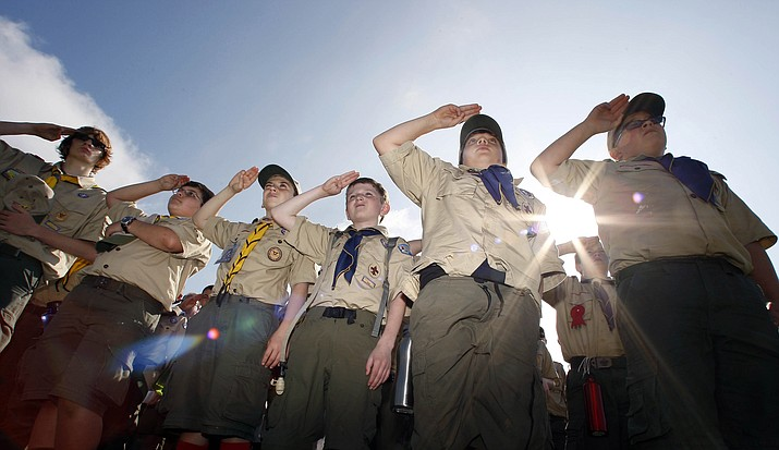 "Boy Scouts salute during a ""camporee"" in 2011 in Sea Girt, N.J. The Boy Scouts of America announced last week that it will admit girls starting next year. (Mel Evans/AP)"