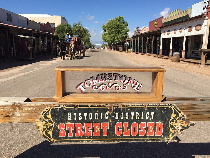 A sign marks a street closed in Tombstone, Arizona. Cochise County Sheriff's Office says a shooting occurred Friday in Doc Holliday's Saloon when two men struggled following a verbal altercation that also involved a woman and a third man. (AP File Photo/Astrid Galvan)