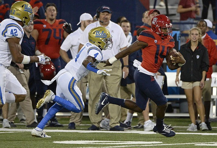 Khalil Tate followed up last week's record-setting performance with another strong one, rushing for 230 yards and two touchdowns to lead Arizona over UCLA 47-30.
