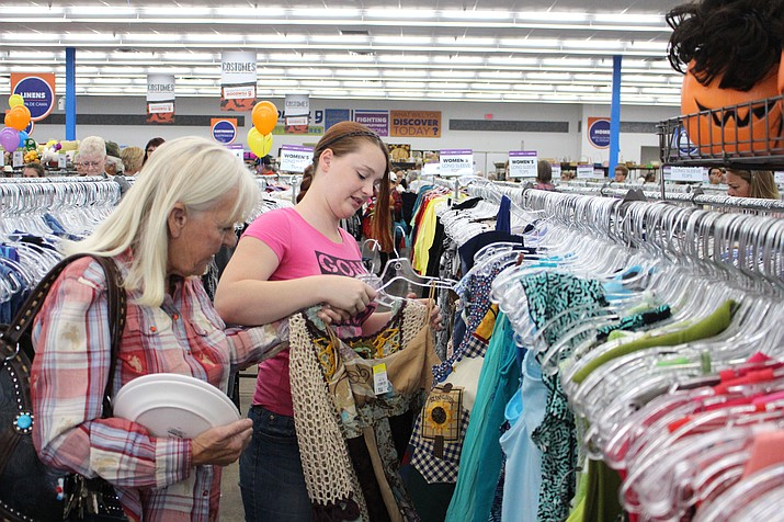 Shoppers peruse the clothes selction at the new Goodwill store at 3320 Stockton Hill Rd.