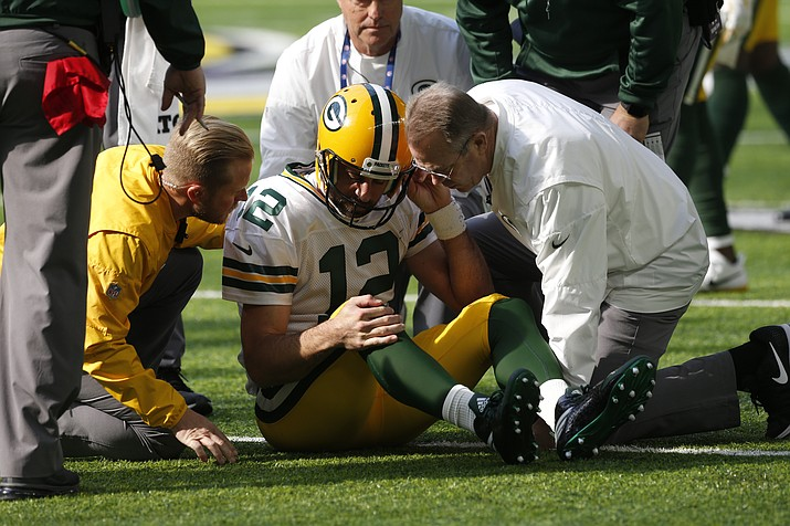 Green Bay Packers quarterback Aaron Rodgers gets up after being hit by Minnesota Vikings outside linebacker Anthony Barr (55) in the first half of an NFL football game in Minneapolis, Sunday, Oct. 15, 2017. (Jim Mone/AP)