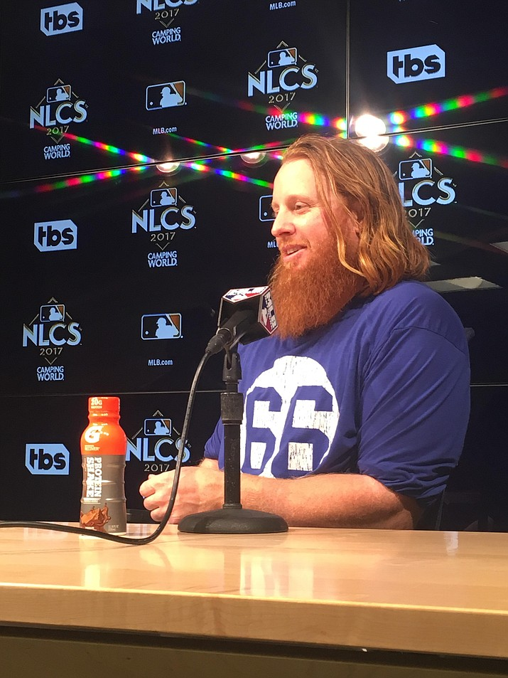 Justin Turner provided his own late-game heroics by crushing a three-run shot to center to give the Los Angeles Dodgers a 4-1 win over the Chicago Cubs.