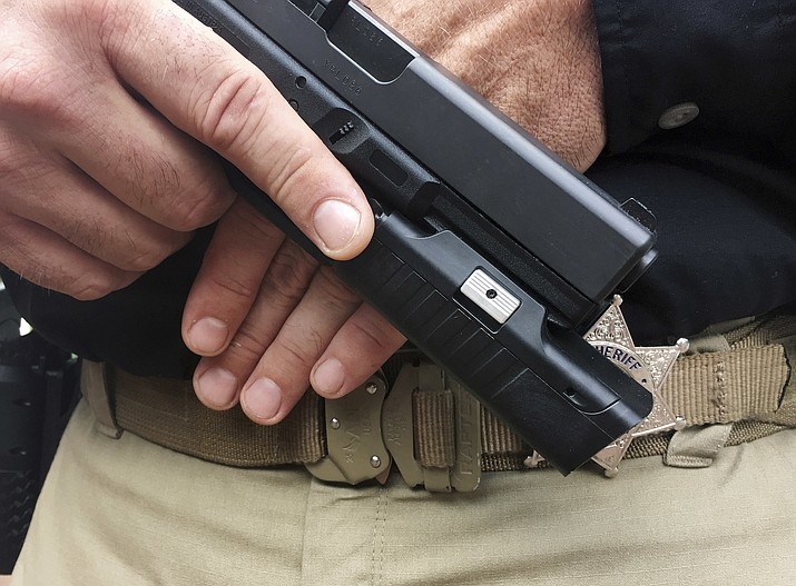 Some police departments, including Williams, Arizona, are considering putting cameras on officers' guns, saying they would give a better, unobstructed view of police-involved shootings and save money on video storage costs compared with body cameras. (Gavin Smith/Centinel Solutions via AP)