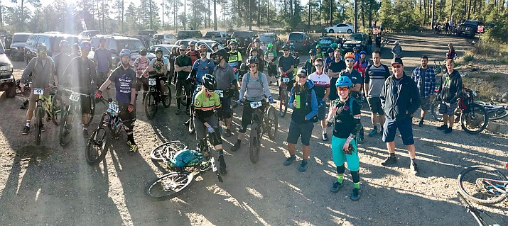140 racers wait for the riders meeting at the Mountain Bike Association of Arizona's final enduro race of the series at the White Rock parking lot in the Prescott National Forest. (Les Stukenberg/Courier)