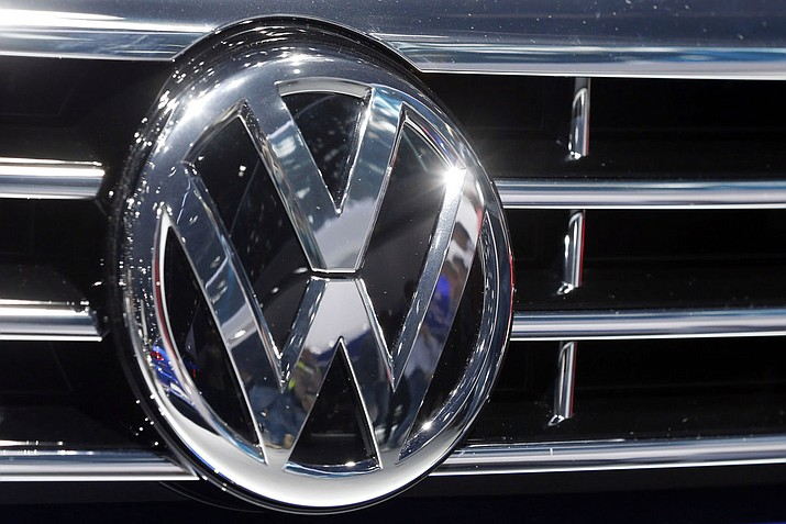 """In new court filings, the legal team for Volkswagen is acknowledging that the company had designed and sold vehicles under the VW, Audi and Porsche labels with """"defeat devices,"""" essentially allowing its cars to emit more pollutants of oxides of nitrogen during actual on-road driving than show up when they are actually being tested. (Michael Probst/AP)"""