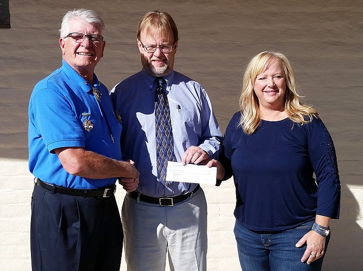 "Tom Disisto from the Jerome Elks Club, left, recently presented a $1,000 check to Clarkdale-Jerome School District Superintendent Danny Brown and Clarkdale-Jerome School Board President Jill Zaske that Brown says ""will go towards our new gym bleachers."" (Photo courtesy Clarkdale-Jerome School District)"