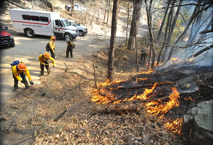 Fire crews work the one-acre Empire Fire in Groom Creek Tuesday afternoon. (Les Stukenberg/Courier)