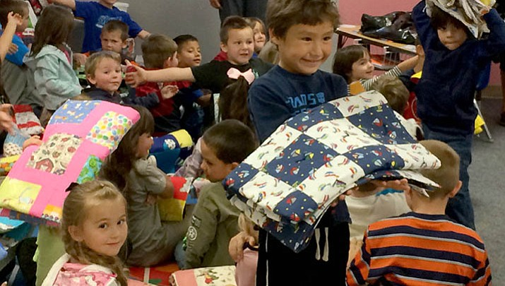 Big Bug Charity Quilters donate blankets to kindergarteners